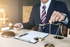 Male lawyer working with gavel and scales of justice, note paper Stock Photography
