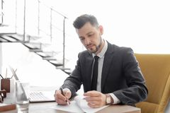 Male lawyer working. In office stock photos