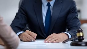 Free Male Lawyer Writing Down Clients Testimony To Make Legal Case, Close-up Stock Images - 161861374