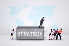 Male leader and his team with strategy Stock Photo