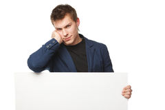 Male leaning on the blank banner Stock Photography