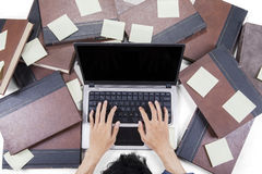 Male learner typing on notebook laptop Royalty Free Stock Photos