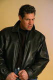 Male in leather. Handsome male portrait. he's wearing a leather jacket and has a look of surprise royalty free stock image