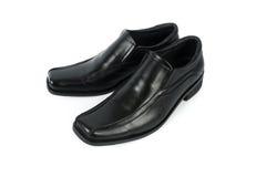 Male leather black shoes isolated on white background Stock Image