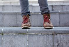 Male leather boots on steps Royalty Free Stock Images