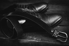 Male leather executive shoes with belt Royalty Free Stock Images