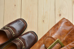 Male leather shoes with leather bag on wooden background. Male leather shoes with leather bag on wooden Royalty Free Stock Photo