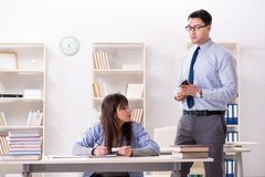 The male lecturer giving lecture to female student. Male lecturer giving lecture to female student Royalty Free Stock Photo
