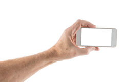 Male left hand holding smartphone with blank screen. Image of male left hand holding smartphone with screen isolated ready for insertion of your application or Royalty Free Stock Images