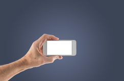 Male left hand holding smartphone with blank screen. Image of male left hand holding smartphone with screen isolated ready for insertion of your application or Royalty Free Stock Image