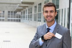 Male with a legal occupation handing a business card Stock Photo
