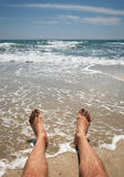 Male legs on the beach Royalty Free Stock Photos