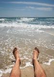 Male legs on the beach Royalty Free Stock Photos