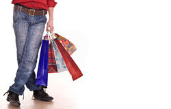 Male legs in blue jeans. Shopping. Royalty Free Stock Image