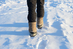 Male legs in boots with galoshes Royalty Free Stock Images