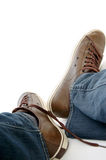 Male legs in brown shoes sneakers and jeans Royalty Free Stock Photography