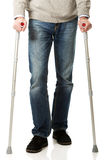 Male legs with crutches. Mature male legs with crutches Stock Photo