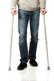 Male legs with crutches. Mature male legs with crutches Royalty Free Stock Photography