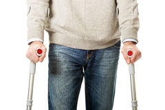 Male legs with crutches. Mature male legs with crutches Stock Images