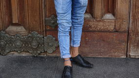 Male Legs And Feet And Blue Jeans. Peruvian adult male wearing blue jeans Royalty Free Stock Images