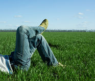 Male legs on the green field Stock Image
