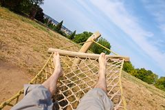 Male legs in a hammock Royalty Free Stock Photography