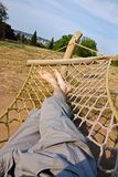 Male legs in a hammock Royalty Free Stock Photo