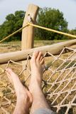 Male legs in a hammock Royalty Free Stock Images