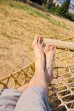 Male legs in a hammock Stock Image