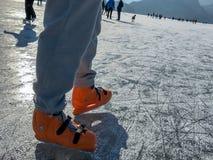 Male legs ice skating Stock Photo