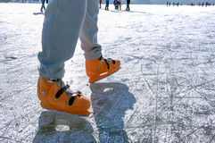 Male legs ice skating Stock Photography