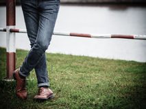 Male legs in jeans and boots Royalty Free Stock Photography