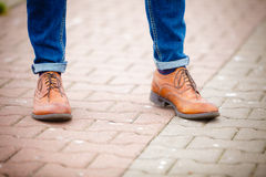 Male legs in jeans and boots Stock Photo