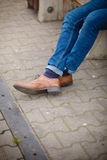 Male legs in jeans and boots Stock Photos