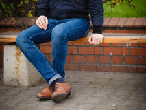 Male legs in jeans and boots Stock Image
