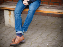 Male legs in jeans and boots Stock Images