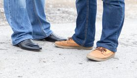 Male legs in jeans and shoes. In the park in nature Royalty Free Stock Photo