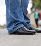 Male legs in jeans and shoes Stock Photos