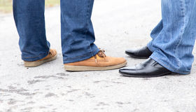 Male legs in jeans and shoes Stock Photography