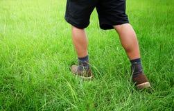 Male legs in lawn Stock Photo