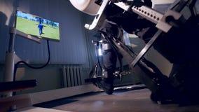 Male legs walking in exoskeleton. Male legs inside exoskeleton stirrups walking and controlling a character in VR stock video