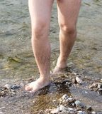 Male legs in water. In the park in nature Royalty Free Stock Photos