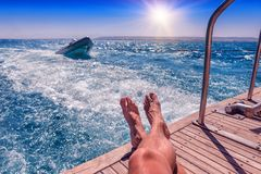 Male legs on a yacht stock photography