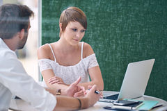Male life insurance consultant giving presentation to prospective female client Royalty Free Stock Photo