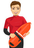 Male lifeguard holding a rescue can Royalty Free Stock Photos
