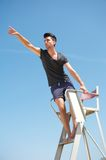 Male lifeguard pointing outdoors. Portrait of a male lifeguard pointing outdoors royalty free stock photography