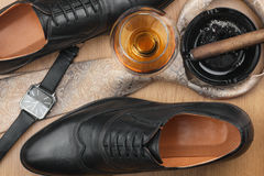 Male lifestyle. Shoes, cigar, tie and alcohol. Royalty Free Stock Photos