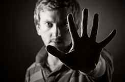 Male Looking at the Camera Through his Hand Stock Photography