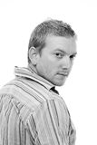 Male Looking at Camera over his Shoulder Royalty Free Stock Photos