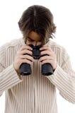 Male looking downward through binocular Stock Photo